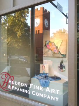 Hudson Fine Art and Framing window with clocktower